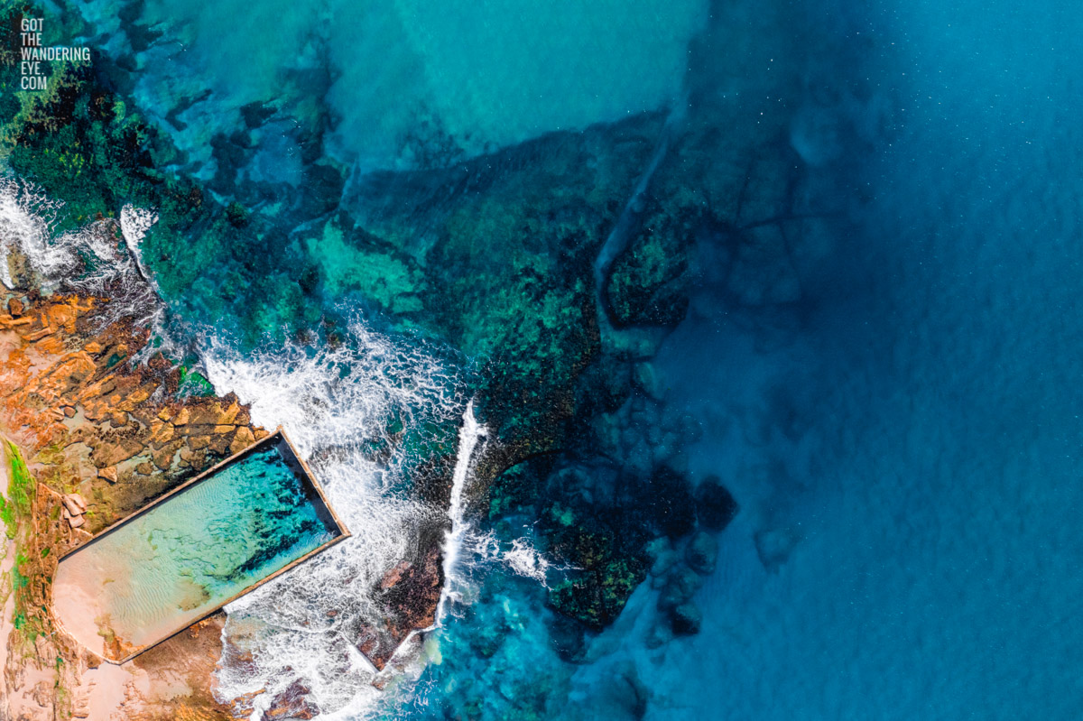 Aerial oceanscape above the gorgeous blue waters of North Cronulla ocean, rockpool. Surrounded by beautful coloured waters like the greek island of Corfu.