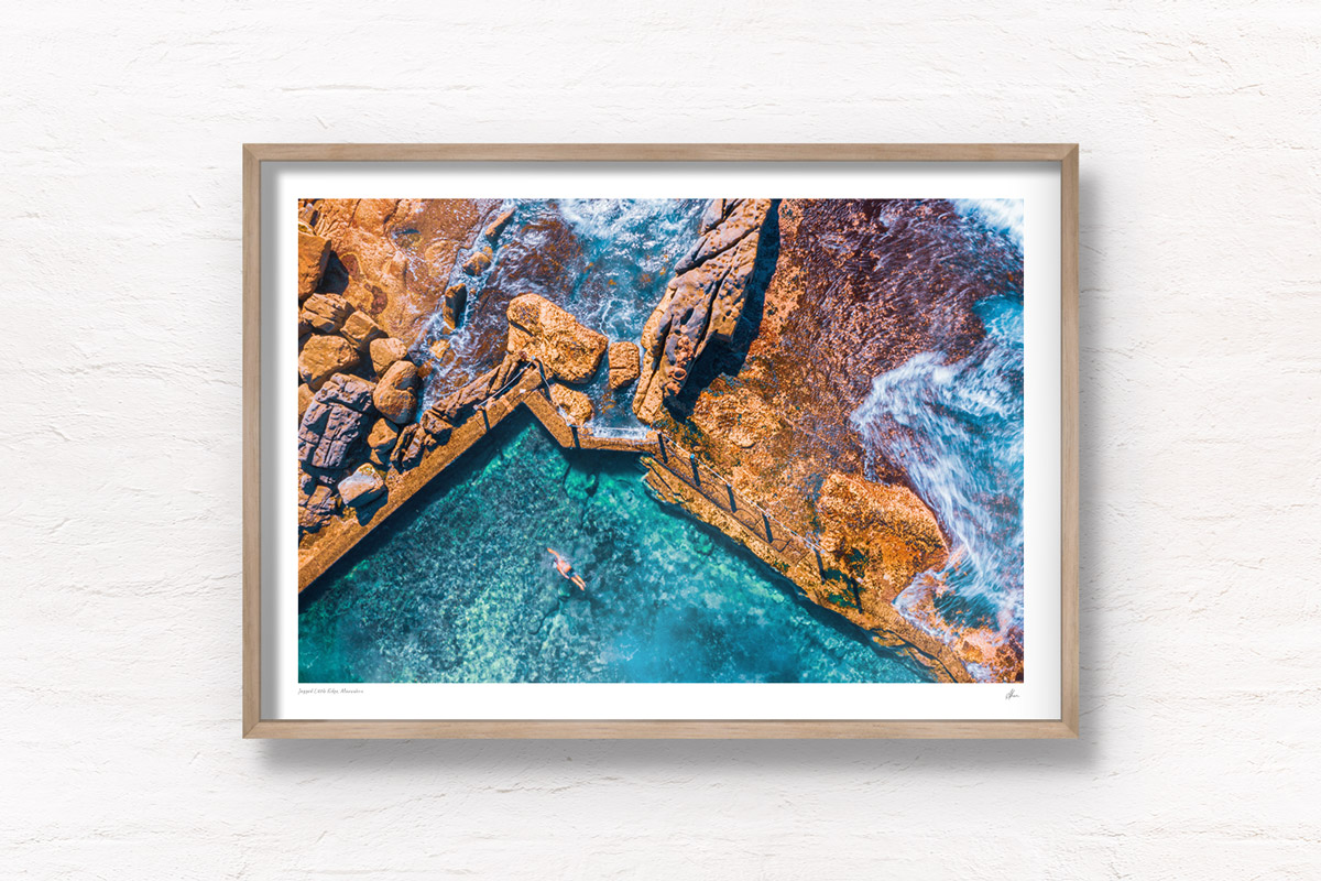 Fine art framed print of a man swimming in crystal clear ocean rockpool waters of Mahon Pool, Maroubra. Summer, swimming, beach, fun