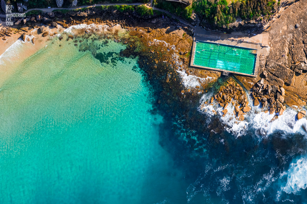 Aerial oceanscape above turquoise crystal clear waters of Freshwater beach and rockpool. Summer, swimming, oceanpool