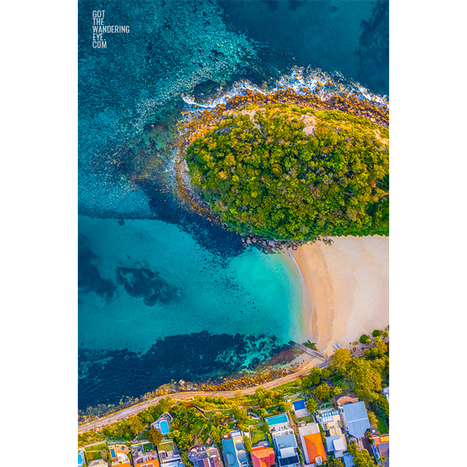 Aerial oceanscape above Cabbage tree Bay aquatic reserve, Shelly Beach, Manly. Ocean, beach, Sydney.