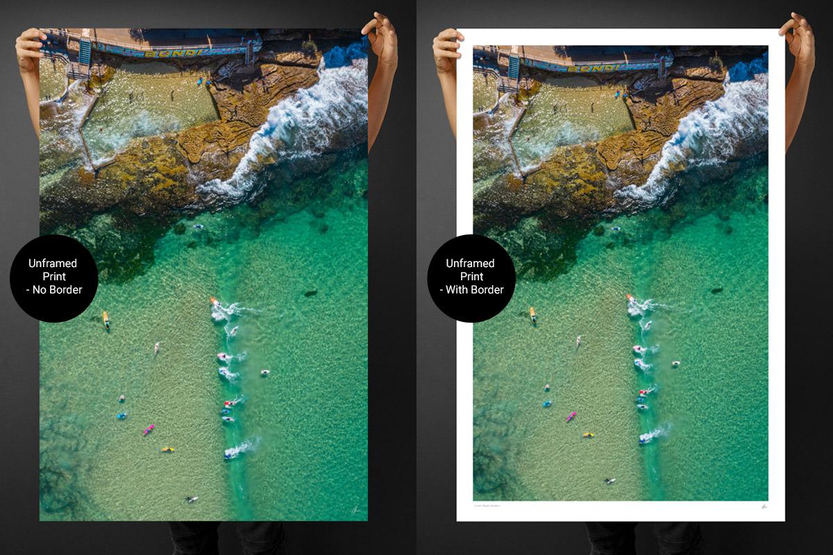Holding aerial seascape print from gotthewanderingeye.com