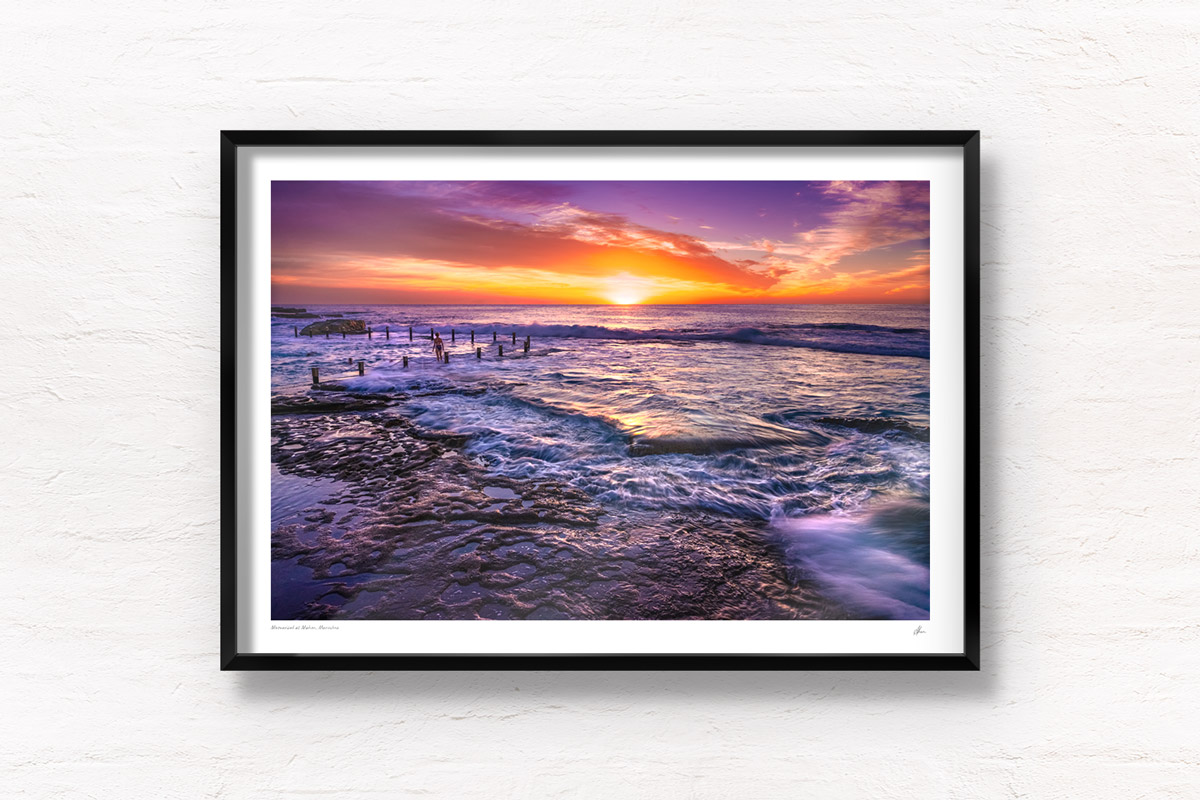 A swimmer mesmerized by a stunning orange, purple sunrise with waves crashing over Mahon Pool, Maroubra by Allan Chan.