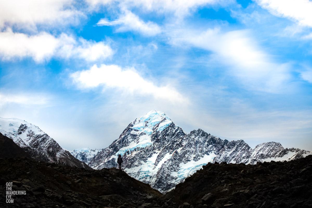 Woman gazing at the peak of Aoraki Mount Cook New Zealand by Allan Chan
