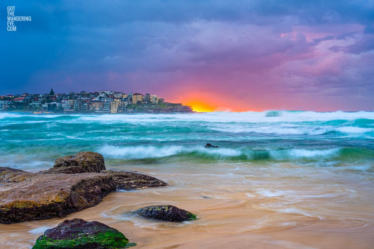 Stormy cloudy sunrise over Ben Buckler at Bondi Beach