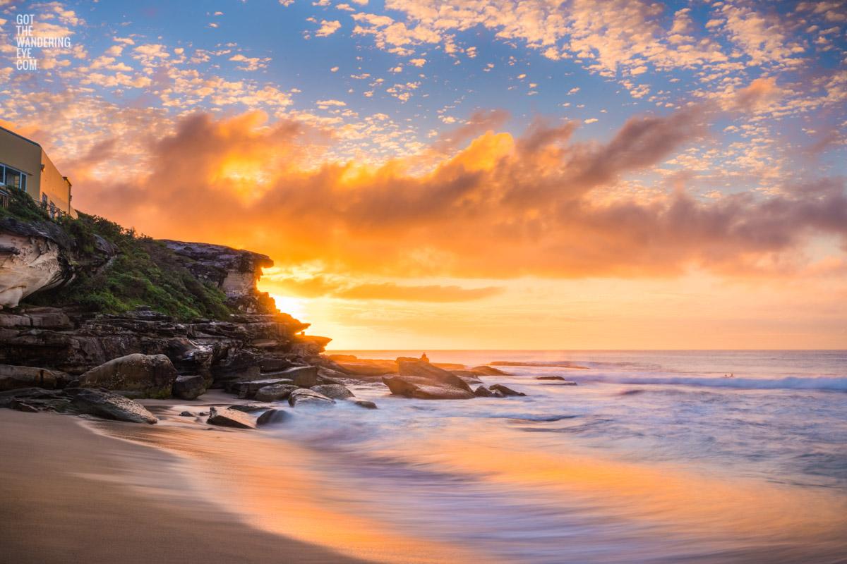 Hot and steamy sunrise above the clifftops of Tamarama point at Tamarama Beach