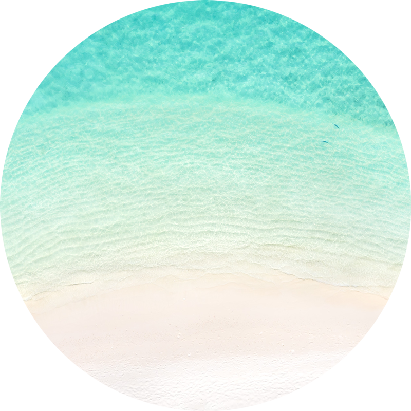 ChromaLuxe round metal print of the ocean. Aerial oceanscape above crystal clear ocean in the island paradise of the Maldives. Wall art delivered and ready to hang.