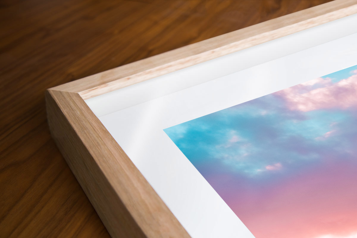 Puffy cotton candy coloured clouds during sunrise at Bronte baths Rockpool. Oak wood framed shadowbox.