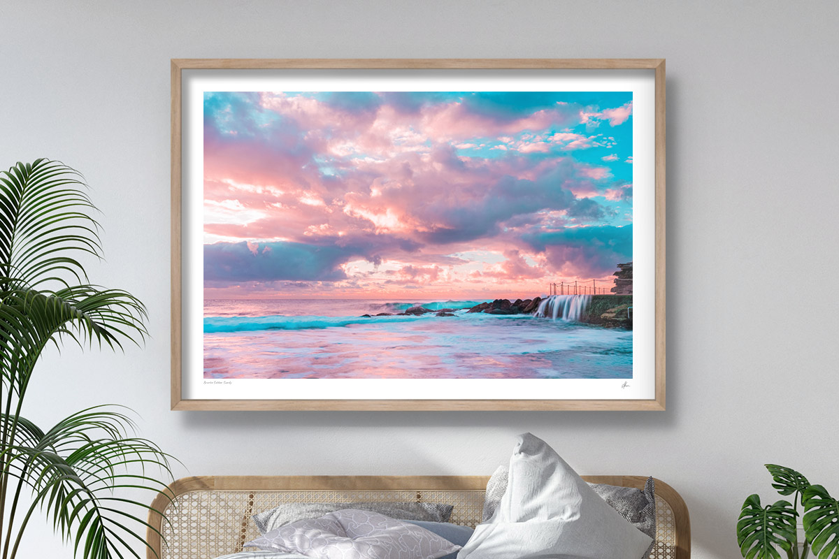 Puffy cotton candy coloured clouds during sunrise at Bronte baths Rockpool. Oak wood framed shadowbox print hanging in modern beachy, coastal bedroom