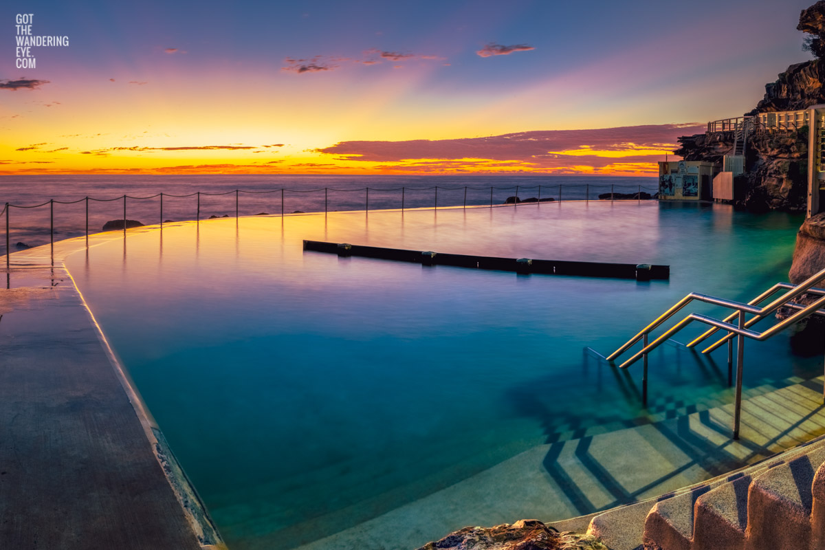 Gorgeous rainbow coloured sunrise over an empty Bronte Baths Rockpool