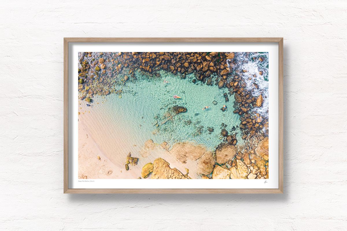 Buy oak framed wall art prints. Swimmers floating in crystal clear waters of Bronte Beach Bogey Hole