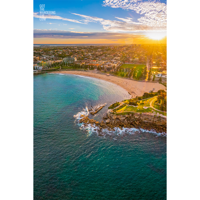 Aerial seascape above Dolphins Point Coogee overlooking a golden sunset, Coogee Beach