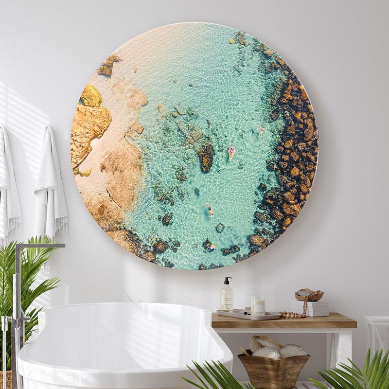 ChromaLuxe round metal print of the Bronte Bogey Hole at Bronte Beach hanging in modern bathroom