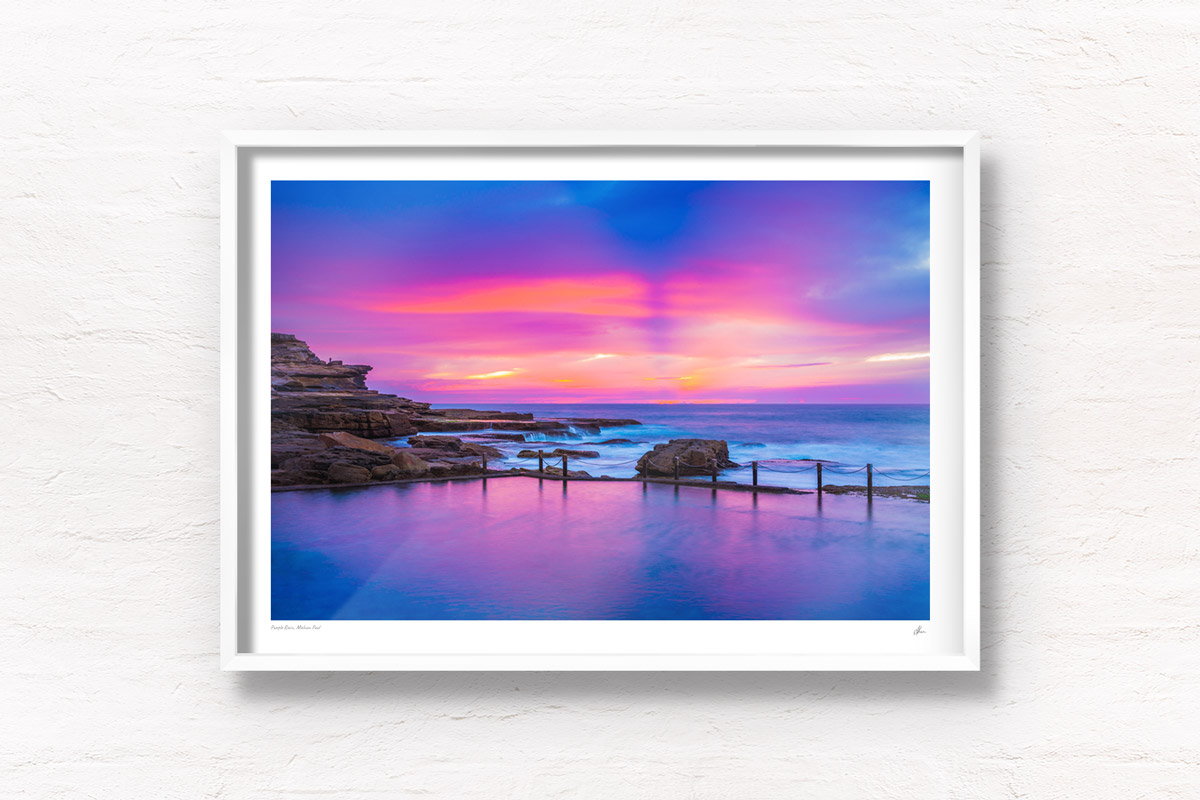 Framed wall art print of a pink and purple aurora sky, over a empty still Mahon Pool, Maroubra